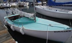 Varnished teak trim and tiller, plus a tiller extension, fiberglass hull. Includes mainsail, jib, bass boat fenders, anchor with chain and rope, Sunbrella cover. 5 HP Tohatsu 2-cycle outboard motor, with adjustable motor bracket. Motor has been winterized