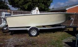 18' center console w/ evenrude 115hp.(trailor included),motor runs great...lt has 120 comperession on all cylinders... The boat is 75% re-done...Nice ext.paint(pastel yellow).The deck has been lifted and cut out completely...All sanding and prep work has