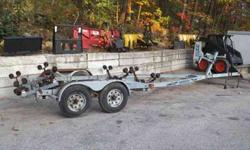 Roller Boat trailer made by Karavan it had a 23 feet boat on it last and had room to spare. The trailer is in great shape, but should have the wheel bearing repacked, it has bearing buddies, but I do not know the last time they were taken apart. The tires