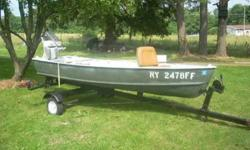 Aluminum 12 ft. V-Bottom Grumman boat, it has a 7.5 hp Scott Atwater 2 cycle motor. Motor runs good, new spark plugs, plus replacment spark plugs. Boat has 2 swivel bass seats, has a 5 gallon gas fuel cell, and has 5 fishing pole mounts. Exterior has new