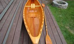 """Bright finish Ultra Light open canoe. 12"""" long about 30 lbs . Made from Tom Hill """"Charlotte"""" plans. Lap strake Okume marine plywood hull. Dynell and West System bottom. Sitka Spruce Rails and Gunwales. Port Orford cedar """" Crowned"""" breast hooks. Brass stem"""