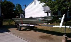 $1200 OBO 14 feet Alumicraft flat bottom john boat Trailer, trolling engine, 2 cushion seats, anchor, wired for running lamps, 9.9 Johnson Outboard engine, gas tank and fuel lines The motor just had the water pump and fuel pump replaced and the lower end