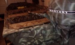 14' custom camo flat bottom for sale, 9.9 mercury motor and trailer...no leaks, fuel lines recently replaced, brand new tires on the trailer, make an offer... asking $1200 OBO