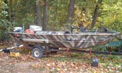 This is a 14 foot flat/semi-v bottom boat. Camo paint. Has a 15hp Evinrude Fastwin motor. Has a 40 lb. truss Minn-Kota troller motor with foot controls and adjustable depth and speeds. Flat platform on front for fishing. Good fishing boat or hunting boat.