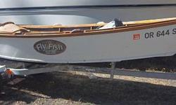 Ken Swann FAMOUS Wooden row boat! $2999 Super Sale $1400 Famous boat 5 hp Mercury 1999 Two swivel seats King 2000 galvanized trailer Email for additional pics....