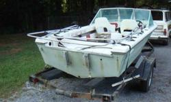 Well cared for Manatee fiberglass shallow draft fishing boat with canopy frame and trailer with winch. 3 almost new tires and spare for trailer. NO MOTOR (STOLEN!) If you know boats--then you know the desirability of these quality built early