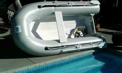 """Hi, I have these brand new hard bottom inflatable boats. They are made of high-quality heavy pvc. The boat is a R.I.B. with the fiberglass bottom, and is a great value for the money. It is 9.5 feet long, 5ft1"""" wide, 120 lbs. holds four people, and up to a"""