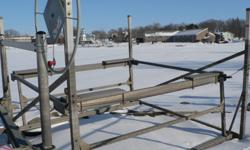 Great shape, Porta-Dock pontoon lift. Set up for 16 - 24ft length pontoons. 2000lb capacity, cantilever style. Delivery, installation, canopies and accessories are available. Located at Beaver Dam Bay Marina in Dodge County. Will hold for purchase with