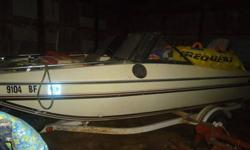nice solid,good running boat, trim & tilt work good with new motor last year. 100hp chrysler was rebuilt 3years age and runs strong always uses amsoil 2 stroke oil it it. Tube goes with boat holds air fine.