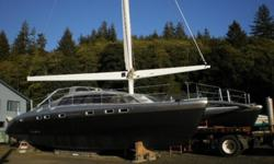 Dual electric windlass, dual Volvo diesel saildrives with full feathering SS adjustable pitch props, electronic engine controls and hydraulic steering, drop down bow beaching ladder, roller furling sails with main electric winch at helm. Designed to be a