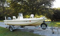50-horsepower 4-stroke outboard motor that starts on the first try and had the oil changed ten running hours ago. The boat has a 12 gallon tank with fuel gauge it gets the best fuel mileage I have ever seen. Also has a 65 lb. trolling motor with a 3