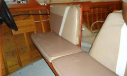 """1962 Thompson Sea Coaster Runabout, lapstrake mohoghany boat with trailer.16' 6"""" length, No motor.always kept indoors, very nice original interior and original Thompson bimini top and side curtains in terrific condition.Needs exterior refinish on deck and"""