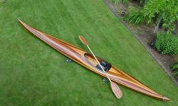 For Sale 17' Cedar strip sea kayak. Completed in Spring 2001. Water tight hatches fore and aft. Custom wooden paddleWeighs 47#. Oneoceankayaks.com design, Expedition Sport. Used 2 times, no scratches, always kept inside the home.Sacrifice at $2500