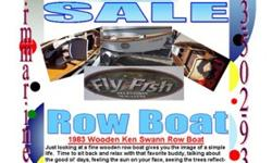 WAS $2999 Go to rmmarine.com 1983 Ken Swann Wooden row boat, w/2000 King Trailer Just looking at a fine wooden row boat gives you the image of a simple life. Time to sit back and relax with that favorite buddy, talking about the good ol' days, feeling the