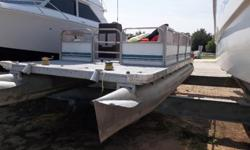 Used 1974 Sanpan 816 (20') pontoon boat with a Johnson 25 hp outboard.