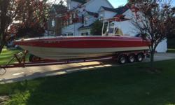 ...//..THIS BOAT IS IN EXCELLENT CONDITION AND IS THE REAL DEAL MOTORS RUN GREAT WITH 560 HOURS ON THEM THIS BOAT RUNS FAST AND HANDLES GREAT. MAKE NO MISTAKE, THIS IS A BIG BOY BOAT THAT MOVES!!HAS BEEN A FANTASTIC FISHING BOAT AS WELL. NEW ROD HOLDERS,