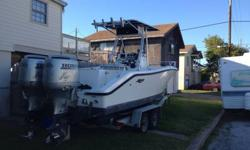 Stock Number: 712917. Very clean year 2000 Mako 23 ft with twin engine Honda 130 HP 4 stroke all the pumps are brand new fresh & salt water 100 gallon gas, 20 gallon fresh water extras include GPS, fish finder, stereo, bathroom, and much more extras.