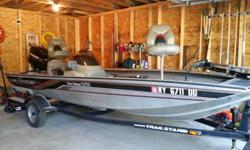 17' Aluminum hull Bass Tracker / 50 HP single outboard, with a brand new cover. Fish finder, electric trolling motor by Motor Guide, 2 news batteries, live well and priced due to MANY extras: life jackets, 2 anchors, bumpers, emergency kit with flares and