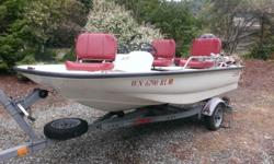 13 ft. 2000 Boston Whaler Sport. Original 25 HP Big Foot Mercury 4 Stroke and hull in excellent condition. Trailer is original 2001 EZ Loader. Lightly used boat placed in the water only a handful of times each year. It has been well maintained. Winterized