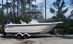2000 Boston Whaler Outrage. Unsinkable. Stored inside since new. Toilet in center console is a must for family boating. Deep V hull with reverse chine provides dry stable ride. Upholstery all looks brand new. This is the most desireable Whaler made in
