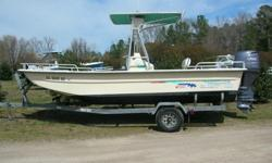 You are looking at a flawless 2000 Carolina Skiff. It is a 198 V Series. It is equipped with a Yamaha 80 hp 4 stroke. The motor is equipped with power tilt and trim and since it is a 4 stroke there is no mixing oil with the gas. The Carolina Skiff 198 V