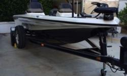 """This is an absolutely gorgeous 2000 Champion Bass boat. 18' 7"""" dual console, 150hp Mercury Optimax injected outboard with stainless steel prop. New upholstery, New 70lb thrust trolling motor with Gator electric deployment bracket. I am the 2nd owner,"""