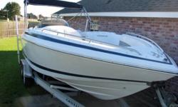 2000 model year 23 Cobalt LS deck boat. Kevlar and composite construction, no wood anywhere. 5.7 litre 260 HP Volvo Penta with stainless steel duroprop. Wet bar, removable porta-poti in change area (I never used it and doesn't appear to have been used),