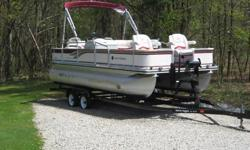 2000 Harris-Koyt 20' 200 Fisherman Floatbote.50 HP Johnson Motor, 2 Stroke .50 lb. Thrust Minkota Trolling Motor .Lorance Fish Finder .12 or 24 Volt Electrical System .2 Swivel Captain Chairs - Front .2 Fold Swivel Chairs - Back .Bench Seat with Table
