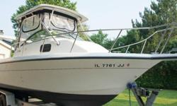 ,.,.,,,This 23' Walkaround is powered with a 200hp Evinrude, Hard Top, trim tabs, platform, bucket helm seats, buddy cabin and more .The Hydra-Sports 230 Seahorse WA is a multi-purpose fishing boat that is part bluewater fishing machine, part family sport