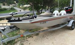 Its' 75 hp Mercury looks new under the cowl and appears to be only used a few hours (however, there is not a clock). Sonar and two live wells make it so easy to catch those fish. Lots of storage space and a strong trolling motor rounds out its' amenities.