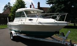 This boat is in great shape, with very low hours and use. This boat is powered by a 3.0L Mercruiser that runs like a champ. The hull is clean, with very few signs of common use. Boats are hard to find with a hard-top, 2 Person cuddy cabin, and in this
