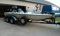 2000 Ranger 518VX Dual Console Bass . 200HP Mercury EFI .Boat and Motor and Trailor in Excellent Condition.ALWAYS GARAGE KEPT.Well Maintained.Lowrance X-25 (color)w/GPS and HD Chip at Helm.Lowrance LMS-320 w/GPS on front deck.101LB Thrust 36 volt