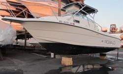 2000 Robalo 2240 WA. This Robalo is in good condition but needs minor TLC ( please see pictures for details). This Vessel floated off its stand during Hurricane Sandy. There was NO water reported in cabin or the engine, the motor is reported to run.This