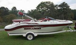 For sale is a 2000 Seadoo Challenger 1800 Jet Boat. It features a 210 hp M2 Jet Drive Motor, Speedometer, Tachometer, Fuel Gauge, Bimini Top, Captain Chairs, Rear Bench Seat, Bow Seats, SunDeck, Built-In Cooler, Retractable Ski Pylon, Swim Platform with