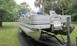 Full Snap-On Mooring CoverSki TowMood LightingPlenty of Cupholders and Storage under seatsGreat floorplanBuilt in CoolerSunPad in rearpop-up changing roomReclining high back captains chairAM/FM Stereo with MP3 Port and 4 SpeakersCocktail table with 4