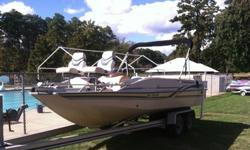 2000 year model Tracker marine Party Deck 21 as shown in the pictures. Includes Motor guide 'beast' trolling motor. 130 hp mercuiser 4 cylinder gasoline engine with aluminum prop. Multi-use boat, fish , ski/tube, cruising, entertaining. open layout with
