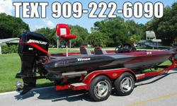 BOAT: (TJZ1P376J800) 2000 TRITON TR-21 20.6' BASS Boat. Color is Red/Black/Silver Metallic - Very Sharp looking! Extremely well built Bass Boat - Top of the Line. The boat is completely solid inside and out! All Compartment lids are in Excellent shape,