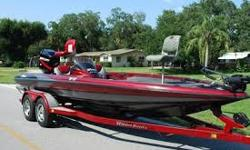 FRESH WATER RUNBOAT: (TJZ1P376J800) 2000 TRITON TR-21 20.6' BASS Boat. Color is Red/Black/Silver Metallic - Very Sharp looking! Extremely well built Bass Boat - Top of the Line. The boat is completely solid inside and out! All Compartment lids are in