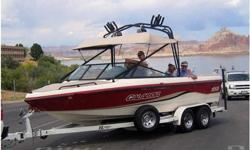 2001 Calabria PRO V 4XS,Excellent Condition, 23-1/2 foot, 210 hrs. Called the Ferrari of Wakeboard and Ski boats, unique ballast system no pumps, fills in less than a minute! Comfortable wrap around seating for 14, hot/cold water shower, teak swim