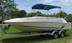 This is the very solid and versatile Cobia 226 Coastal Deck boat powered by a Yamaha 200HP fuel injected outboard with a stainless steel propeller. This is a one owner boat purchased locally buy the seller in 2001 and it has been kept in outstanding