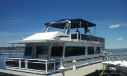 Two bedroom but sleeps 6 comfortably with sofa sleeper. Kitchen island with bar stools for eating and entertaining. Big bathroom with shower. Large front deck for cruising or head up top to the fiberglass fly bridge with controls on the sun deck and enjoy