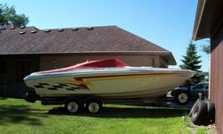 2001 26' Powerquest with trailer and cover, big block MPI Mag 454, Captains choice exhaust, loaded and in great shape. Boat has been stored inside and cleaned after each use. Can be seen in Fremont, WI. Inside is immaculate. Red carpet, white interior