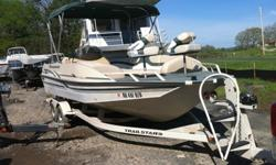 2001 Tracker Deck Boat, 21 ' with 190 HP Merc Inboard, with Trailer. 2 Front Swivel Fishing Seats, Live Well, AM/FM/CD Stereo, Storable Table, Swim Step with Fold Down Ladder, Trolling Motor, Humming Bird Depth Finder, New Steering Cables, Boots - Boat
