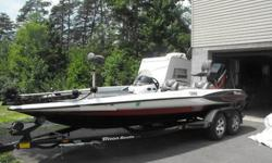 2001 Triton TR21 bass boat pushed with a Mercury 225 HP EFI engine in great shape and running strong with jackplate. Has Motorguide Tour Edition digital 24Volt trolling motor with gator mount. Has a Lowrance LMS 160 sonar/GPS fishfinder at the wheel and a