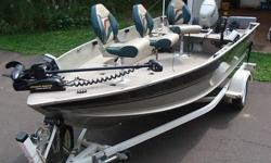 Original owner of a used 2002 Alumacraft Navigator 165 with a 2003 Honda 50hp 4 stroke motor with an extra prop. Also comes with a roller trailer with a spare tire and carrier. This boat has a 21 gallon gas tank, bilge pump, live well, rod and bulk