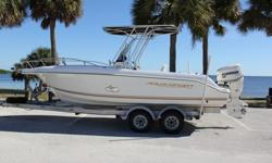 This is a very nice 2002 Aquasport 205 Tournament Edition center console. The engine is a 2009 Evinrude E-Tec. The dealer printout shows the engine has 257 hours of use on it and is under the BRP Extended Factory Warranty until 03/2016. This boat is