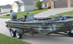 2002 21ft F & F custom built jon boat and a 1994 150 hp Mercury outboard. This is the ultimate fishing, hunting and pleasure boat. You can fish out of it all morning and ski and tube all afternoon. It is 88 inches wide with 24 inch sides so it can take on