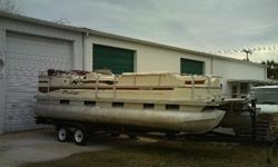 2002 LIBERTY BY FISHER .2003 MERCURY 90HP OUTBOARD.TANDEM AXLE TRAILER INCLUDED.Well laid out pontoon with loads of room for your family, their family...everyones' family. Toon is very clean for the year and has been well maintained. Upholstery and