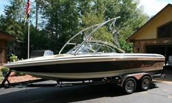 THIS RIG HAS ONLY 274 HOURS WITH A LONG LIST OF OPTIONS THAT INCLUDE: FULL FACTORY COVER, POLISHED ALUMINUM WAKEBOARD TOWER, POWER WAKE TABS, FULL GUAGES WITH DEPTH METER, FIBERGLASS SWIM PLATFORM, POP UP CLEATS, AM/FM/CD, LUXURY EDITION INTERIOR AND