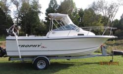 Beautiful 22' Bayliner Trophy Fishing Pro. Low 400 hours on the Mercruiser 190 HP 4.3L engine. She runs perfect. Trim tabs get her on plane and keeps her running smooth even on rougher water. Non Skid deck. Raw Water Wash down. Anchor with lines, Fenders